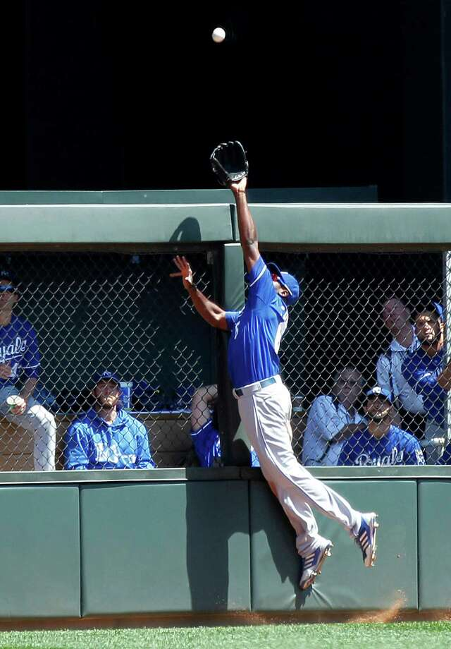 Kansas City Royals center fielder Lorenzo Cain jumps and makes the catch on a ball hit by Minnesota Twins' Trevor Plouffe in the fifth inning of a baseball game in Minneapolis on Thursday, Aug. 1, 2013. The Royals won 7-2. (AP Photo/Andy King) ORG XMIT: MNAK110 Photo: Andy Clayton-King / FR51399 AP