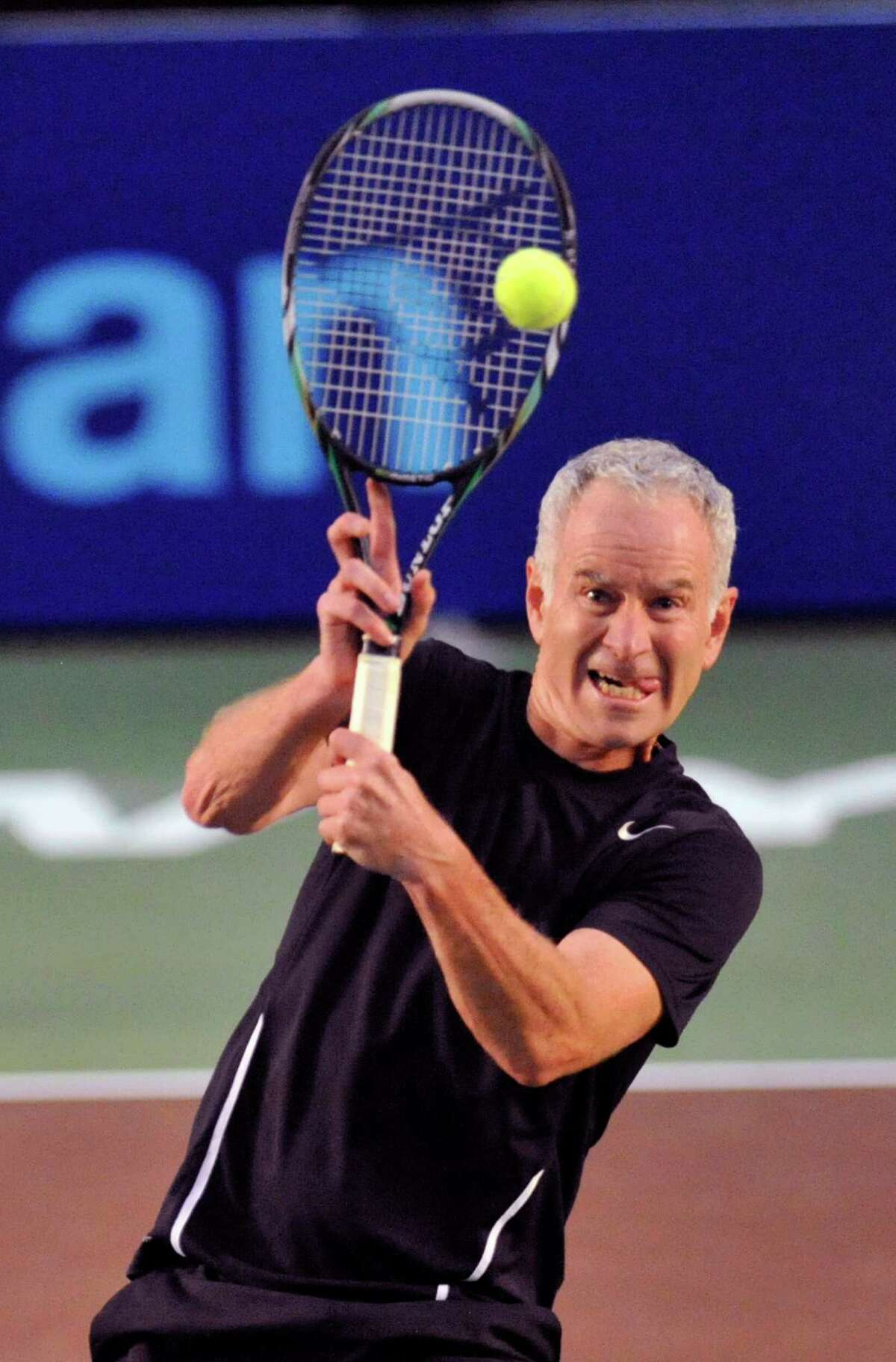 John McEnroe of the New York Sportimes returns the ball against the Orange County Breakers in a World Team Tennis match at SEFCU Arena in Albany, N.Y., Thursday, July 18, 2013. (Hans Pennink / Special to the Times Union) ORG XMIT: HP101