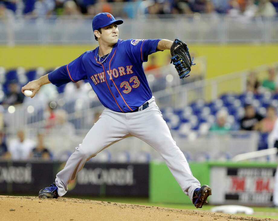 New York Mets' Matt Harvey delivers a pitch during the first inning of a baseball game against the Miami Marlins, Thursday, Aug. 1, 2013 in Miami. (AP Photo/Wilfredo Lee) ORG XMIT: FLWL103 Photo: Wilfredo Lee / AP