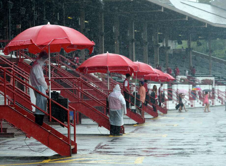 Heavy rains came down Thursday afternoon,  Aug. 1, 2013 at Saratoga Race Course in Saratoga Springs, N.Y. (Skip Dickstein/Times Union) Photo: SKIP DICKSTEIN