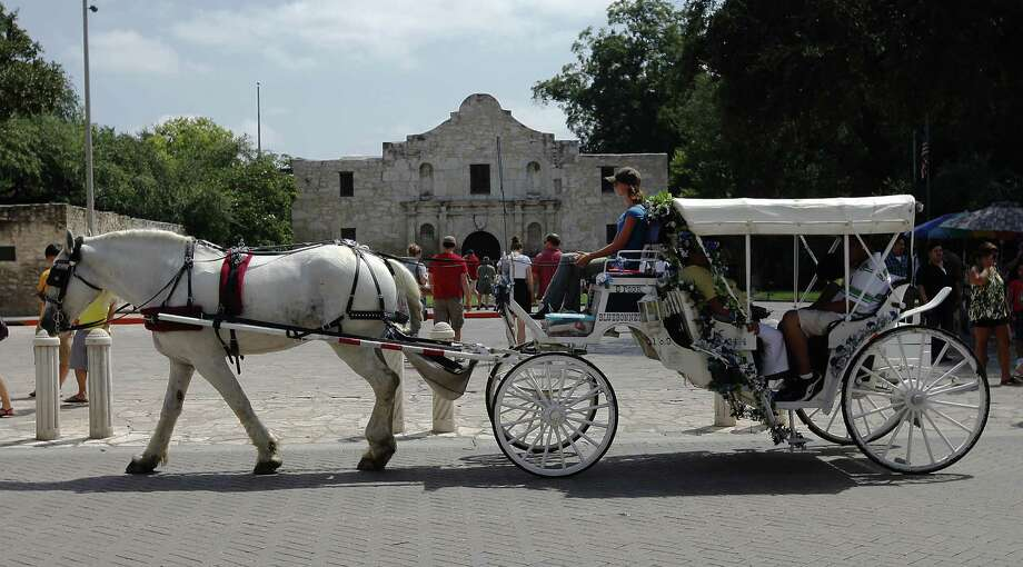 New regulations covering carriages will lower the horses' maximum workday length from 10 to eight hours. Photo: San Antonio Express-News / File Photo