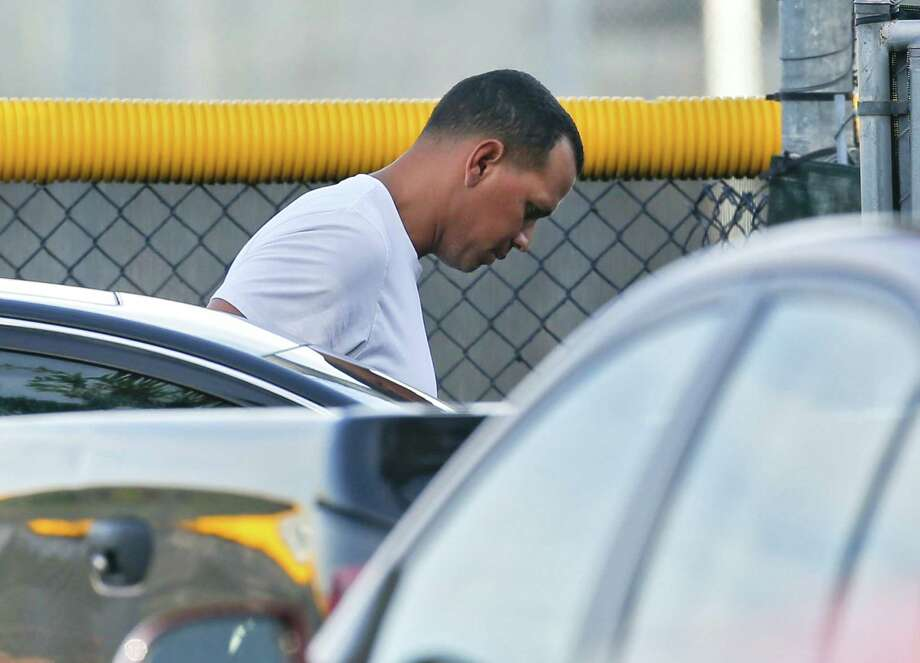 New York Yankees third baseman Alex Rodriguez arrives to workout at the Yankees minor league complex Thursday, Aug. 1, 2013, in Tampa, Fla. Major League Baseball is threatening to kick A-Rod out of the game for life unless the New York star agrees not to fight a lengthy suspension for his role in the sport's latest drug scandal, according to a person familiar with the discussions. The person spoke to The Associated Press on Wednesday, July 31, 2013 on condition of anonymity because no statements were authorized. (AP Photo/Chris O'Meara) ORG XMIT: FLCO101 Photo: Chris O'Meara / AP