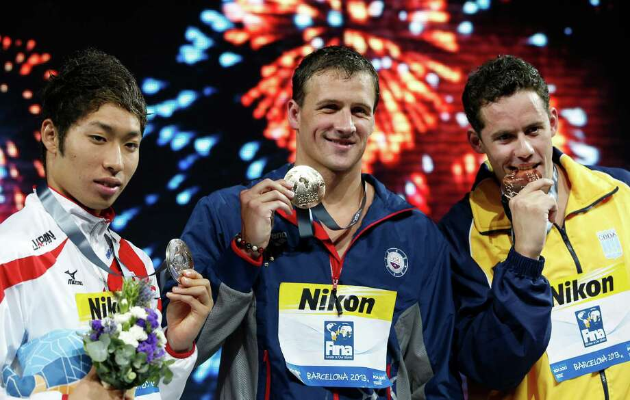 From left: Japan's Kosuke Hagino, silver,  Ryan Lochte of the United States, gold, and  Brazil's Thiago Pereira, bronze, during the medal ceremony Men's 200m individual medley final at the FINA Swimming World Championships in Barcelona, Spain, Thursday, Aug. 1, 2013. (AP Photo/Michael Sohn) ORG XMIT: WSC271 Photo: Michael Sohn / AP
