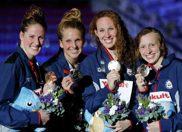 The United States team, from left: Missy Franklin, Karlee Bispo, Shannon Vreeland and Katie Ledecky smile as they pose with their gold medals that they won in the Women's 4x200m freestyle relay final at the FINA Swimming World Championships in Barcelona, Spain, Thursday, Aug. 1, 2013.  (AP Photo/Daniel Ochoa de Olza) ORG XMIT: WSC362 Photo: Daniel Ochoa De Olza / AP