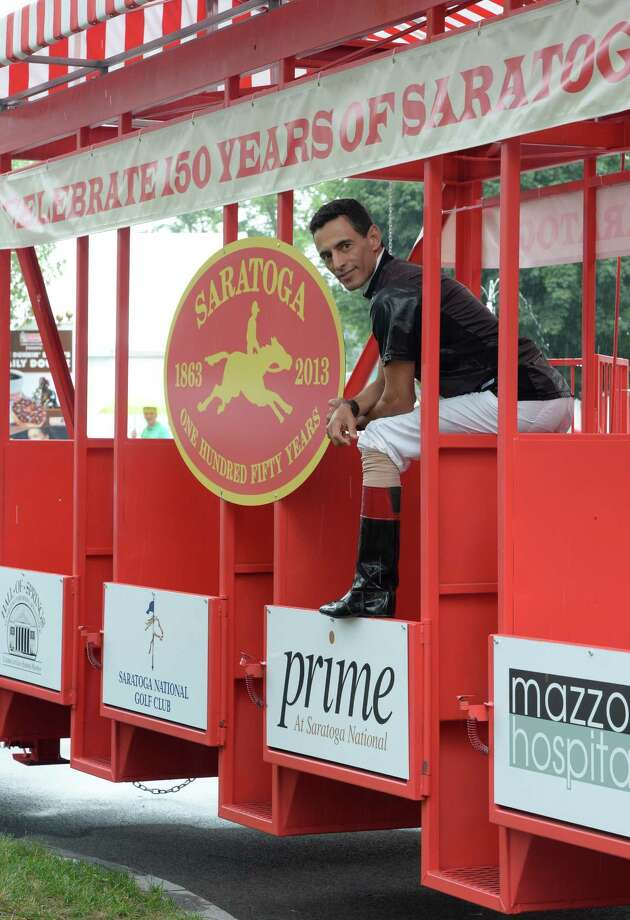 Jockey John Velazquez tries out the 150 Celebration starting gate float Thursday, Aug. 1, 2013, at Saratoga Race Course in Saratoga Springs, N.Y.  Jockeys from Saratoga Race Course will ride the float in a parade Friday evening. (Skip Dickstein/Times Union) Photo: SKIP DICKSTEIN