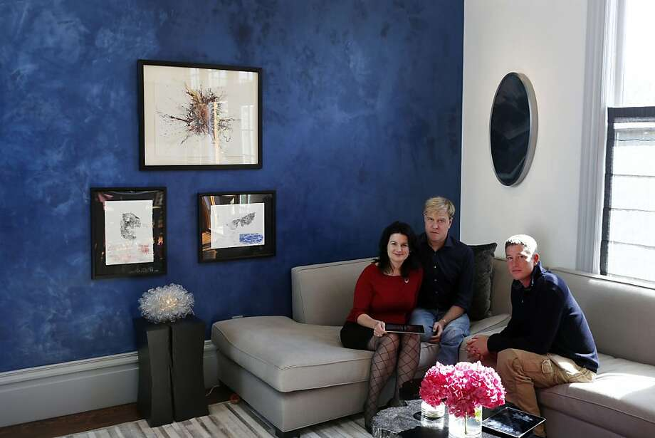 Kristine Boyden and Scott Taylor (center) in their home in San Francisco's Castro neighborhood with their contractor, Aaron Gordon. The couple and the contractor used Houzz as a resource in remodeling the flat. Photo: Ian C. Bates, The Chronicle