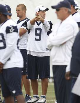 Quarterback Tony Romo (09) gestures while discussing a play during the morning session of the 2013 Dallas Cowboys training camp on Thursday, Aug. 1, 2013, in Oxnard, Calif. (Kin Man Hui / San Antonio Express-News) Photo: Kin Man Hui, San Antonio Express-News
