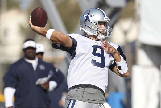 Quarterback Tony Romo rears back for a pass during the afternoon session of the 2013 Dallas Cowboys training camp on Thursday, Aug. 1, 2013, in Oxnard, Calif. (Kin Man Hui / San Antonio Express-News) Photo: Kin Man Hui, San Antonio Express-News