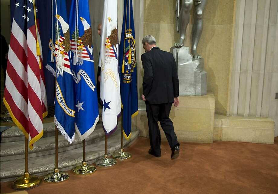 Outgoing FBI Director Robert Mueller walks off stage after his farewell ceremony at the Justice Department in Washington, Thursday, Aug. 1, 2013. Mueller is stepping down in September after 12 years heading the agency.  (AP Photo/Evan Vucci) (AP Photo/Evan Vucci) Photo: Evan Vucci, Associated Press