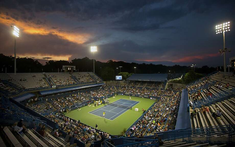The sun sets behind William H.G. FitzGerald Tennis Center during a match between Juan Martin del Potro, from Argentina, and Bernard Tomic, from Australia, at the Citi Open tennis tournament in Washington, Thursday, Aug. 1, 2013. (AP Photo/Pablo Martinez Monsivais) Photo: Pablo Martinez Monsivais, Associated Press