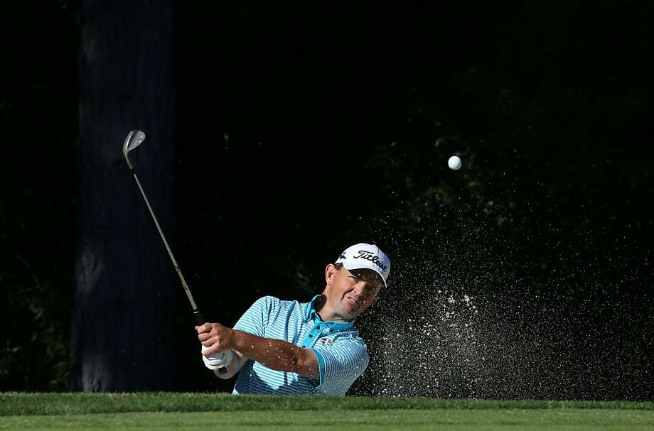 RENO, NV - AUGUST 01: Greg Chalmers of Australia hits out of a bunker on the 16th hole during the first round of the Reno-Tahoe Open at Montreaux Golf and Country Club on August 1, 2013 in Reno, Nevada.  (Photo by Stephen Dunn/Getty Images) Photo: Stephen Dunn, Getty Images