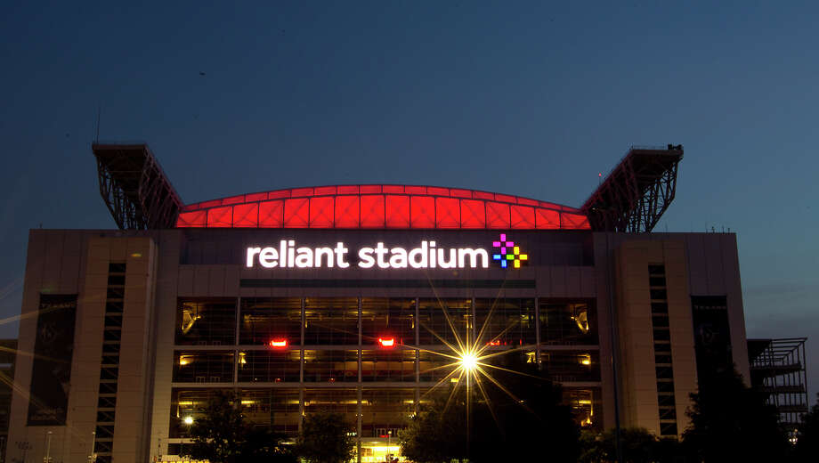 Reliant Stadium glows red as crews test the Houston Texans' new digital HD video board, Friday, Aug. 2, 2013, in Houston. The board has a display area of 14,549 square feet compared to the old board which had 2,592 of space. The screen will be the largest in-stadium HD video display in the world. Photo: Cody Duty, Houston Chronicle / © 2013 Houston Chronicle