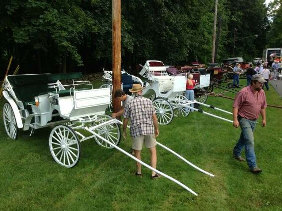 Carriages are unloaded for Friday night's Saratoga 150 Celebration Floral Fete in Saratoga Springs. (Skip Dickstein/Times Union)