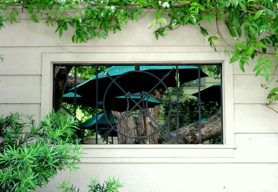 Garden wall windows allow sneak peeks in and out of the garden room.