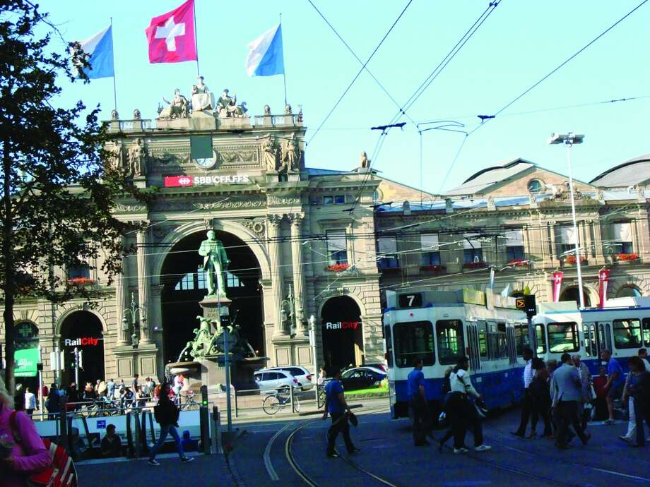 One of Zurich's long trams passes near the central railway station and the Sihlquai bus terminus. Photo: Sandy Rao, For The Express-News