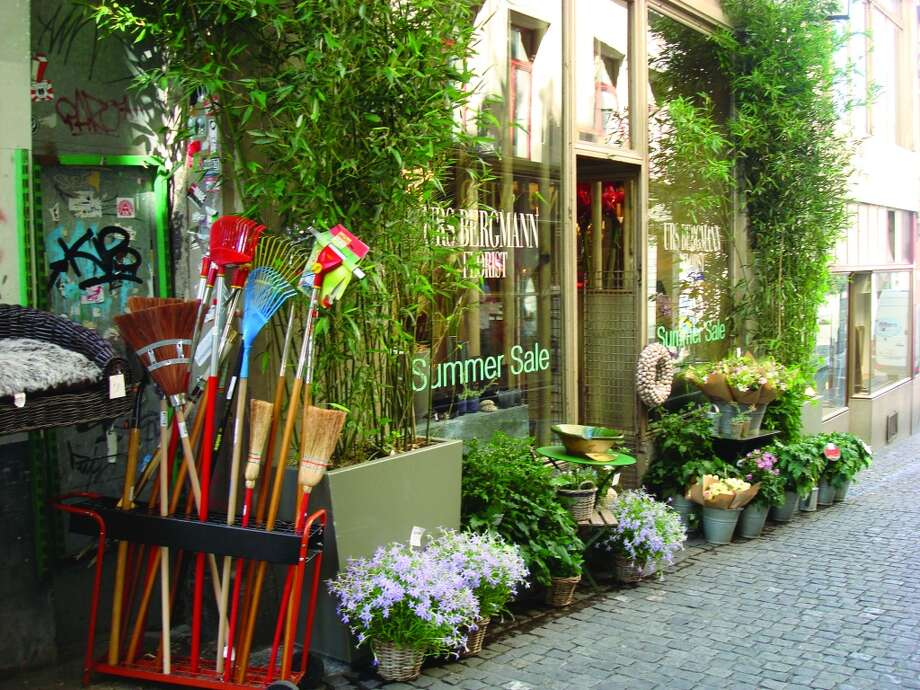 A summer sale includes plants and garden implements on a side street in the Old Town area of Zurich. Photo: Sandy Rao, For The Express-News