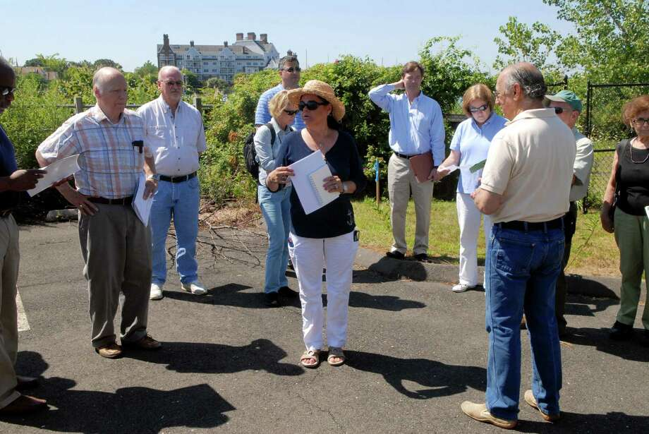 "In advance of the Planning Board's review of a license agreement between the city and developer Building and Land Technology, the Planning Board conducts a site visit to 205 Magee Ave. and the proposed ""Bridgewater"" site on Bateman Way in Stamford, Conn. on Friday August 2, 2013. Teri Dell, chair of the planning board, speaks to the group. Photo: Dru Nadler / Stamford Advocate Freelance"