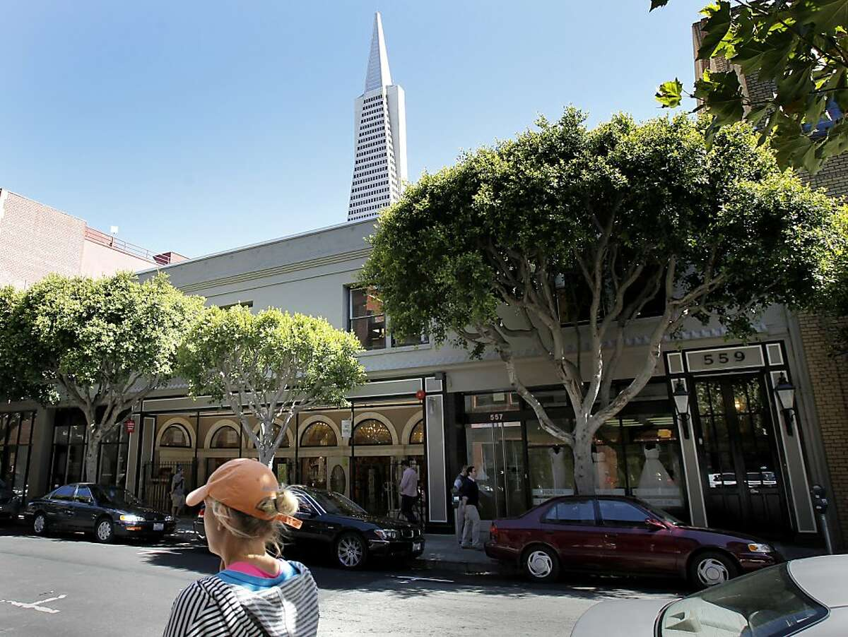 A view from the north side of Pacific Street showing the building at 549-559 with the Transamerica Pyramid in the background Thursday August 1, 2013. The San Francisco, Calif building at 549-559 Pacific Street was the site of a 1983 discovery of three Columbian Mammoth skeletons and a giant bison skeleton found during excavations.