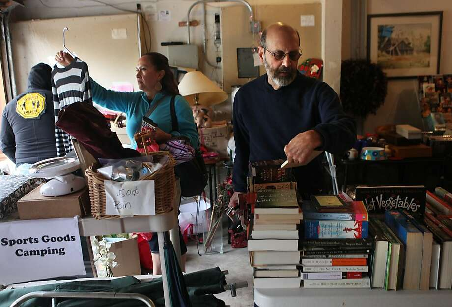 Adriana Lopez (left) and Dick Terdiman shop at a Glen Park rummage sale to raise money for Freedom Socialist, which shuns traditional advertising. Photo: Liz Hafalia, The Chronicle