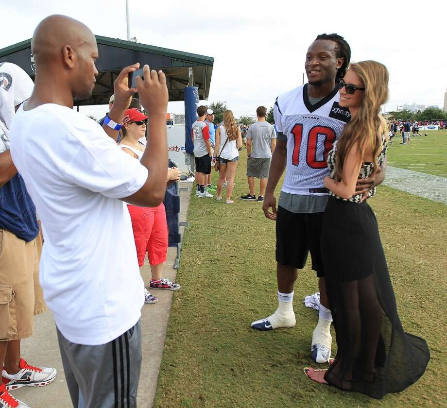 Wide receiver DeAndre Hopkins and his girlfriend, Jennifer Lemmons, get their photo taken by his step-father Wayne Moore after finishing practice on Friday. Photo: Karen Warren, Chronicle