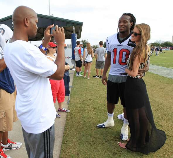 Wide receiver DeAndre Hopkins and his girlfriend, Jennifer Lemmons, get their photo taken by his ste