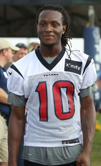 Wide receiver DeAndre Hopkins smiles after practice.