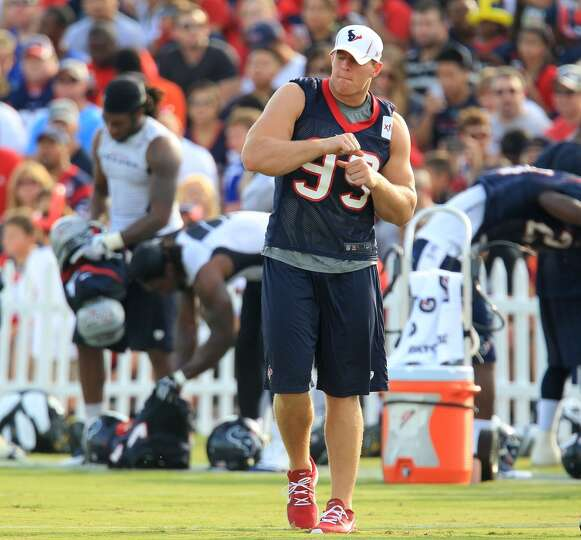 Defensive end J.J. Watt dances to some music at camp.