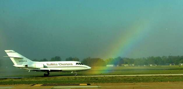 A rainbow formed in the spray from the arc of water coming from an airport firetruck as the plane carrying the body Pfc. David Drake, who died September 28, 2011, arrived at the Jack Brooks Regional Airport   The funeral was October 11, 2011 at Victory Temple Assembly of God Church on South 11th. Street in Beaumont.   Dave Ryan/The Enterprise