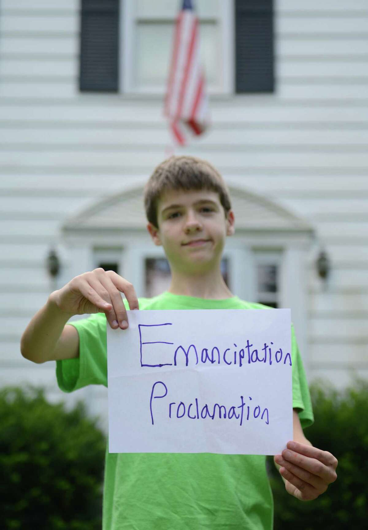 Thomas Hurley III, poses for a photo outside his home in Newtown, Conn. on Friday, August 2, 2013. The 12-year-old recently appeared on Jeopardy, spelling
