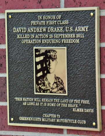 Community members gathered Friday morning at Freedom Park in Lumberton to honor one of their heroes. A special service was held for fallen soldier Army Pfc. David Drake, who died in the line of duty on Sept. 28, 2011 in Afghanistan when an improvised explosive device detonated. A plaque was revealed and dedicated in his memory. Photo: Cassie Smith