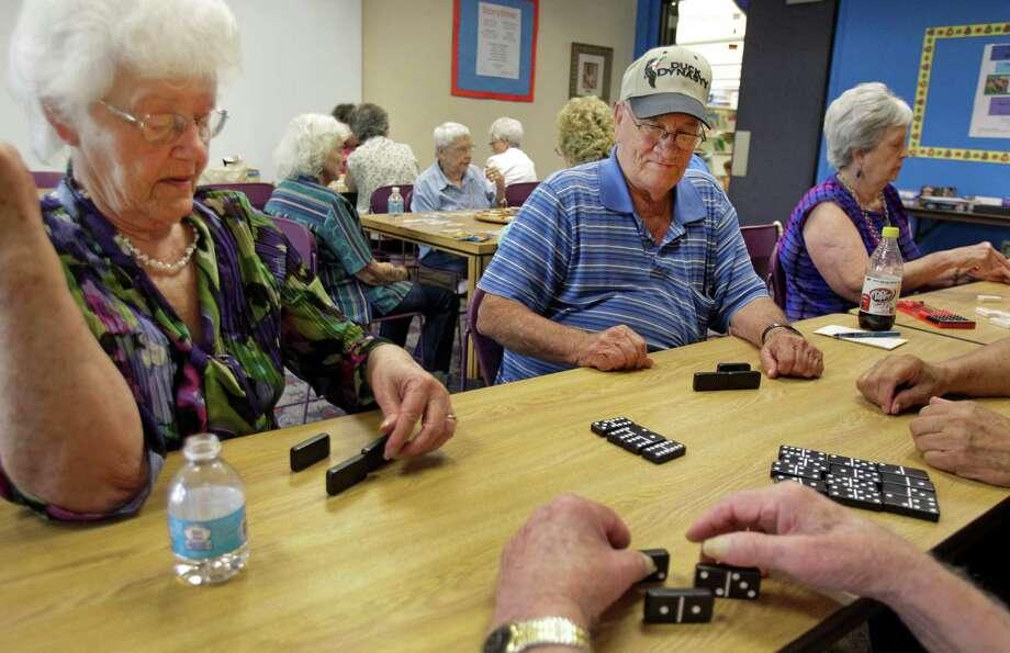 Wednesdays are Senior Game Morning at Harris County Public Library's Barbara Bush Branch in Spring. Photo: Melissa Phillip, Houston Chronicle / © 2013  Houston Chronicle