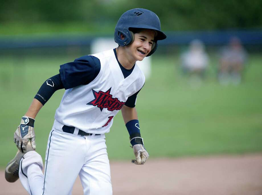 Westport's Ricky Offenberg rounds the bases after hitting a home run against Orange during Saturday's Little League Section 1 tournament game at Frank Noto Field in West Beach Park in Stamford, Conn., on July 20, 2013. Photo: Lindsay Perry / Stamford Advocate