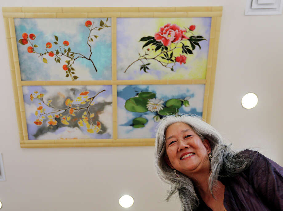 """Portrait of artist Nancy Enkoji with her paintings """"Four Seasons"""" Thursday Aug. 1, 2013 in the Jingu House at the Japanese Tea Garden. Photo: Edward A. Ornelas, San Antonio Express-News / © 2013 San Antonio Express-News"""