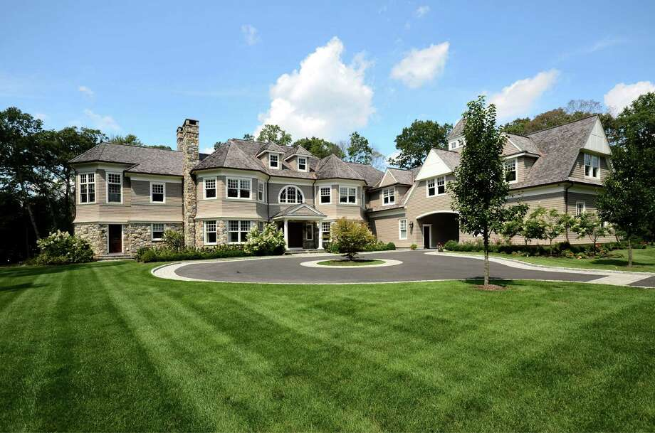 The 22-room house at 10 Heather Drive in New Canaan has more than 15,000 combined square feet, including a two-lane bowling alley and a movie theater. It is listed for $3,999,000. Photo: Contributed