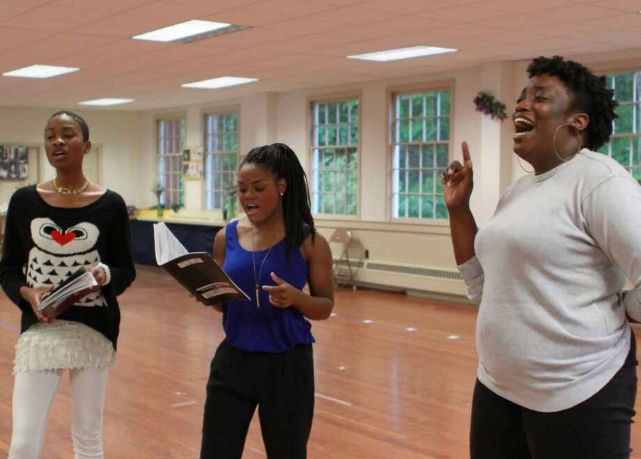"The ""Dreamgirls,"" from left, Jenlee Shallow, Ashley Jeudy and Sheniqua Trotman, rehearse for the Wednesday, Aug. 7, 2013, opening of the Michael Bennett show at the Ivoryton Playhouse in Essex, Conn. Photo: Contributed Photo"