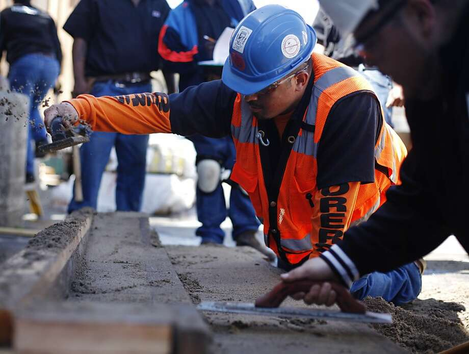 Francisco Dominguez works on curbs and gutters during a class in April at City College of San Francisco. A merger  with San Francisco State University could save embattled City College. Photo: Lea Suzuki, The Chronicle