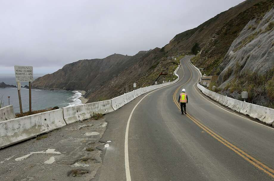 Caltrans construction manager, Ed Der, walks along the now abandoned 1.1 mile long section of highway 1 at Devil's Slide as seen on Thursday August 1, 2013, in Pacifica, Calif. San Mateo County is planning to open the closed section of the Devil's Slide to public access. After the completion of the Tom Lantos bypass tunnels last March the abandoned 1.1 mile long stretch of highway 1 through Devil's Slide, will be converted to include trails, outlooks and bike paths giving people spectacular views of the rugged coastline. Photo: Michael Macor, San Francisco Chronicle