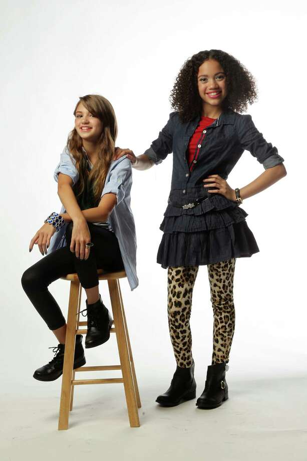 Ma'at Bingham, right, is wearing a Guess denim tiered drsss, $44.50; Guess leopard leggings, $14.62 (sale); Guess knit top, $26; and Report boots, $55; Guess bracelet, $18; all from Macy's. Elle Morgan is wearing a Ralph Lauren shirt, $45; Jessica Simpson T-shirt, $26; Guess leggings, $22.50; and XOXO boots, $60; All from Macy's. Their earrings, $52, and Morgan's ring, $70,  are from  Kendra Scott Rice Village. 