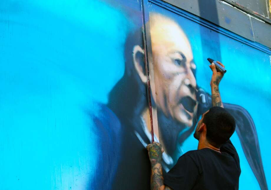 Rashid adds detail to a depiction of accordion legend Flaco Jimenez. Photo: Emily Bamforth, Express-News