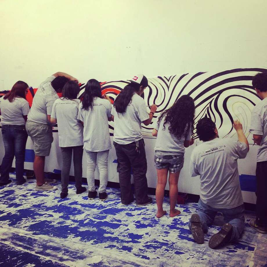 Students from MOSAIC,  Blue Star Contemporary Art museum's education program, San Anto Cultural Arts students and community volunteers all worked on a mural which will go in the Nolan underpass leading to the East Side. The students depicted here are from MOSAIC. Photo: Courtesy Photo