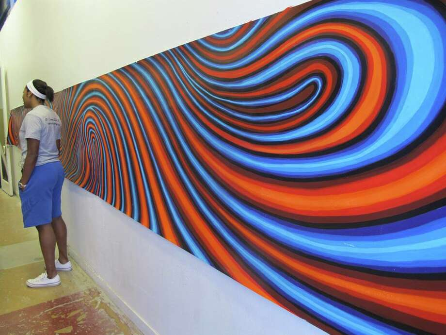 The idea behind the mural is movement - the colorful lines will be seen by passing cars. There's not much pedestrian traffic through the underpass. Photo: Courtesy Photo