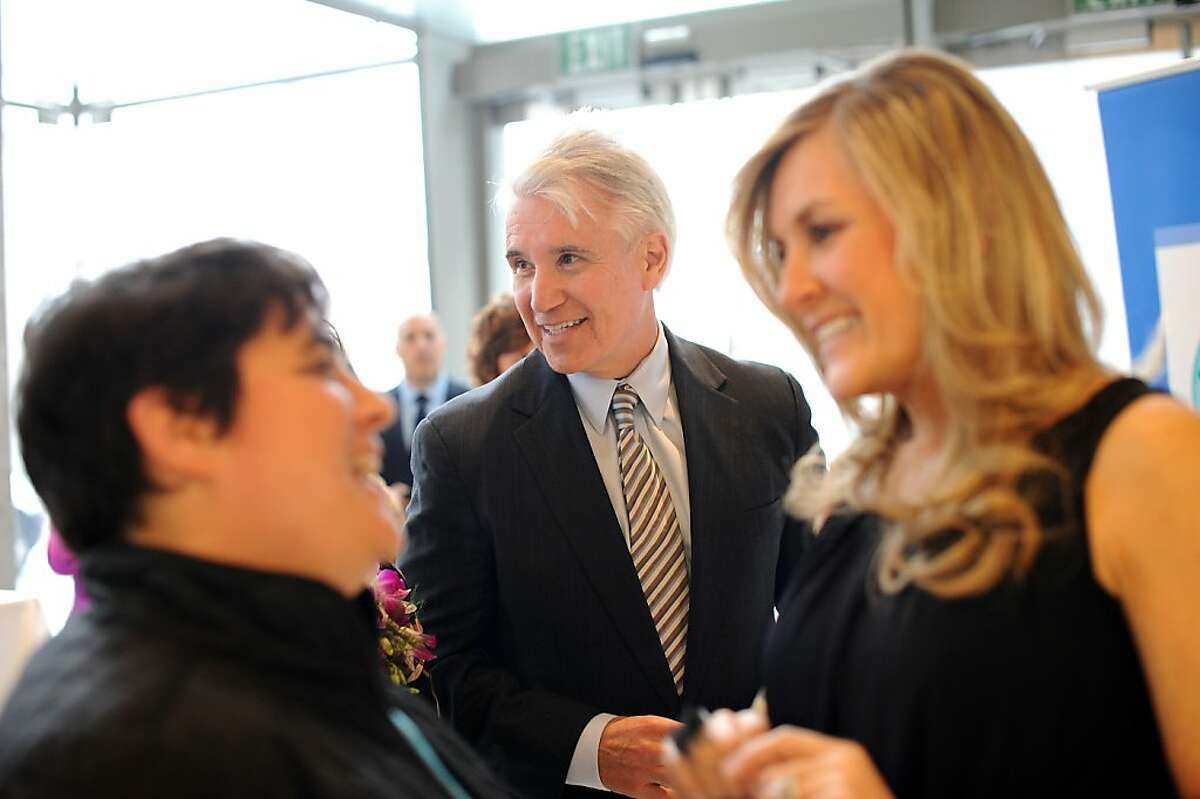 San Francisco District Attorney George Gascon(center) and his wife Fabiola attend the Women Making History Awards Ceremony in San Francisco, CA Tuesday March 19th, 2013.