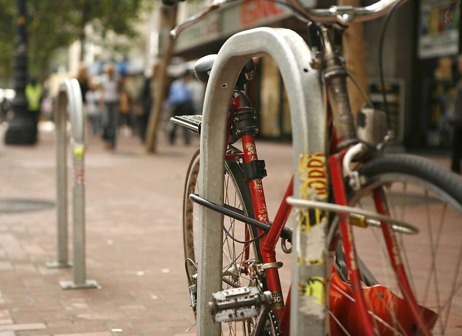 It's a good idea to secure your bicycle with locks that capture both the wheels and the frame. Photo: Jasna Hodzic, The Chronicle
