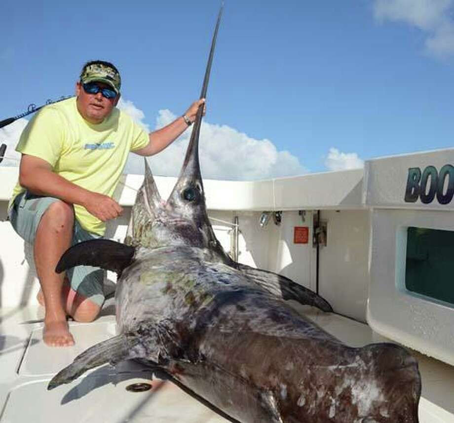 Bryan Barclay caught this 493-pound swordfish in the Gulf of Mexico June 4 with a rod and reel to set a new state record. Photo: TPWD