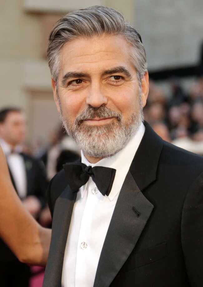 George Clooney's sculpted jawline is frequently requested by male patients, especially men in their 40s and beyond. Photo: Jeff Vespa, WireImage