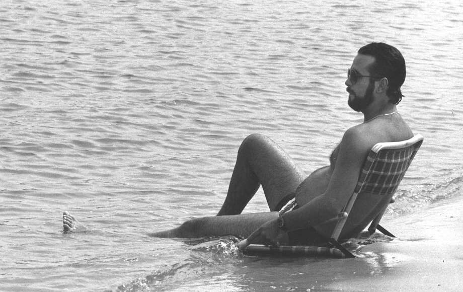 Pete Fitzgerald relaxes at the water s edge at Byram Beach in August 1988. Photo: Greenwich Time