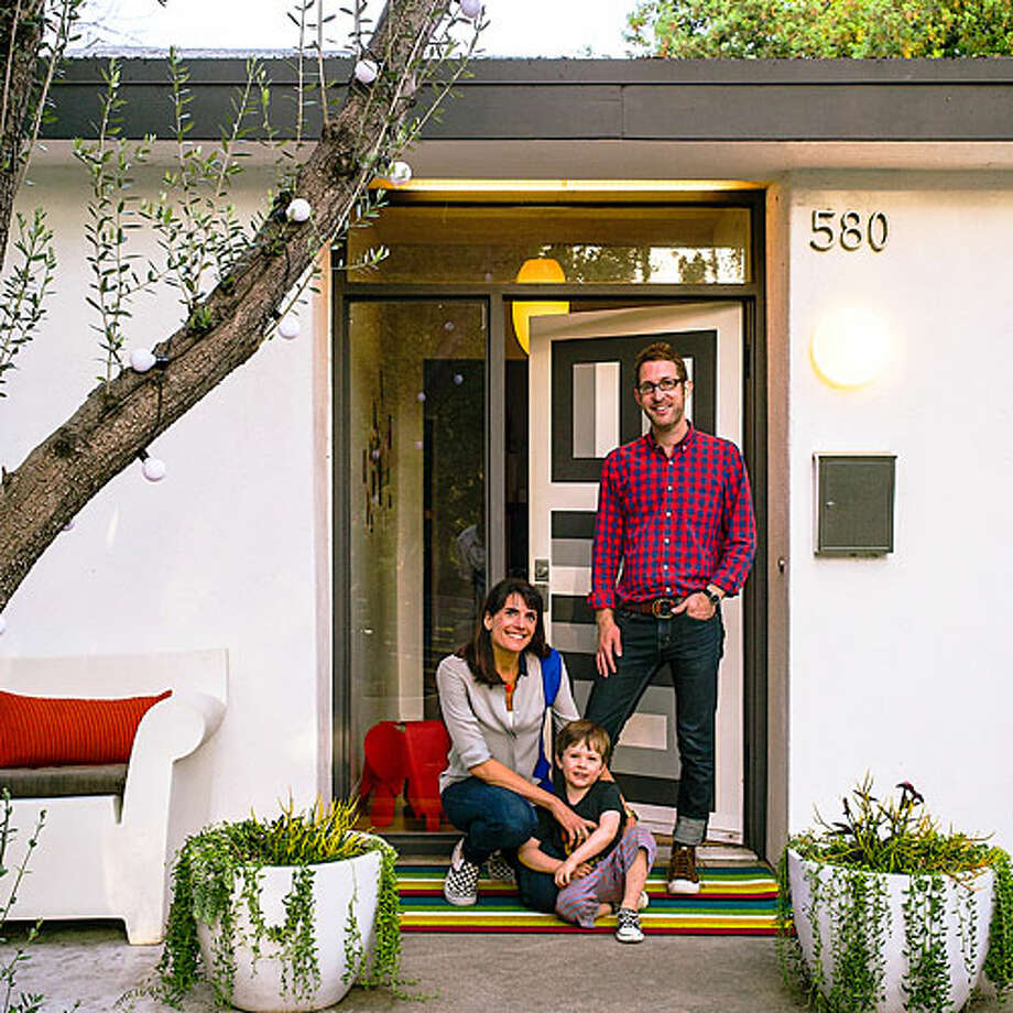 """The no-fear guide to color  One look at the electric blue and gray hexagonal tile in Jon Leaver and Tyke O'Brien's kitchen, and you wouldn't think they went with the safe choice. But in the couple's 1940s Pasadena bungalow, """"safe"""" is a relative term. """"For us, it's a bigger risk to do something boring,"""" says O'Brien.  The whole house reflects that spirit of brio. Inspired by photos of rooms with dark walls, the couple—both teachers who moonlight as interior designers—painted the kitchen cabinets and walls charcoal gray and covered the floor in the colorful geometric tile. Their living room palette? Teal and hot yellow. Even the front door didn't escape without a graphic motif.To make room for all this color and pattern, the couple left most walls pale gray or white. """"Light dove gray is the best canvas to set artwork against,"""" O'Brien says. """"We love how color pops against it."""" When a space has one big gesture, such as the wallpapered accent wall in the master bedroom, they left the other elements neutral for balance.Their best advice, however, comes from blowing through lots of color experiments that didn't work: Accept that you'll make mistakes, then paint over them. obrienleaverdesign.comRead more: 15 favorite color palettes Photo: Thomas J. Story, Sunset.com / Thomas J. Story/Sunset Publishing"""