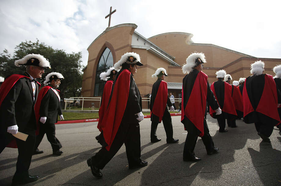 With their black suits and more-colorful regalia, members of the Knights of Columbus exhibit pomp and pageantry as they go about their charitable works. The largest organization of its kind, the Knights have 100,000 members in Texas alone. Photo: Express-News File Photo