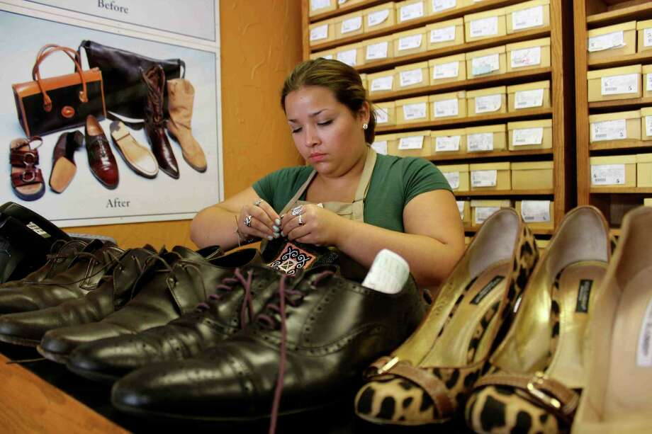 Cobblestone Shoe Hospital between Alamo Heights and Terrell Hills has acquired the assets of Central Shoe Repair. At xxxx is Gabriella Curbeira, niece of store manager Jesus Guzman, who has been filling in on Saturdays for eight months. Photo: Photos By Yvonne Zamora / For No