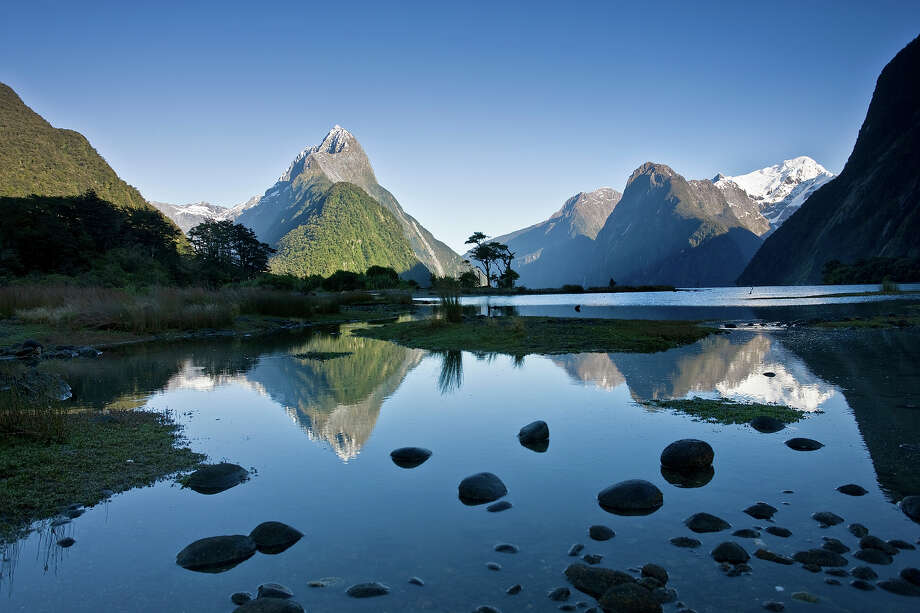 """New Zealand: Te Wahipounamu – South West New Zealand""""The landscape in this park, situated in south-west New Zealand, has been  shaped by successive glaciations into fjords, rocky coasts, towering  cliffs, lakes and waterfalls. Two-thirds of the park is covered with  southern beech and podocarps, some of which are over 800 years old. The  kea, the only alpine parrot in the world, lives in the park, as does the  rare and endangered takahe, a large flightless bird."""" — UNESCO Photo: Frans Lemmens, Getty Images / (c) Frans Lemmens"""